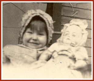 Here is Donna Raye, at about 2 years old, with her aunt's doll.